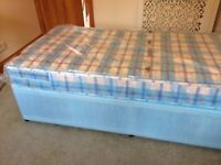 Single Divan Bed with storage underneath and with mattress in plastic cover