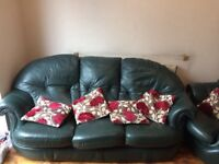 3seater and 1 chair genuine dark leather, slight damage on sofa arm. Excellent condition