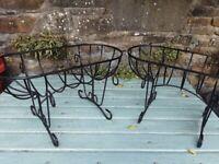 Two black cradle garden planters