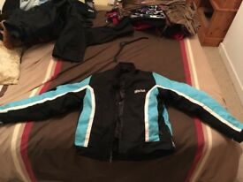 Ladies Blue bike jacket,size 14, and black bike trousers, size large, gloves and helmet