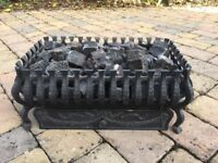 Gas fire basket with coal effect.