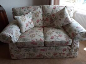 Two seater sofa and two reclining chairs