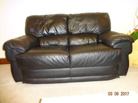 Black 2-seater leather sofa