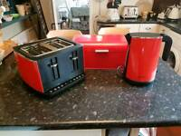 Red Hotpoint toaster, kettle and bread bin set