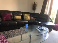 Oval glass coffee table, sturdy, good condition