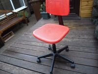 Red plastic swivel chair