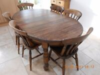 Antique Oak Dining Room Table and Six Chairs with winding handle mechanism to extend table
