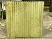 Feather egde fence panels pressure treated green