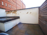 A large 2 bedroom flat with private patio garden moments from Camden Town station and High Street