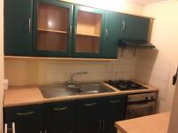 Used Modern Green Kitchen unit & display cabinets, sink, gas hobs, electric oven and extractor fan.