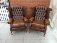 A Pair Of Tanny Brown Leather Chesterfield Queen Ann Armchairs