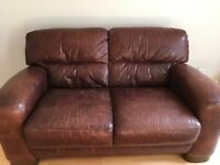 Barker&Stonehouse Two seater Dark brown leather sofa in good condition slight wear and tear