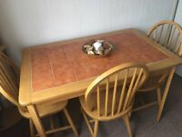 Tile top dining table & three chairs