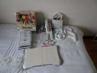 Nintendo Wii Bundle with Wii fit board & Family Trainer Mat plus other extras