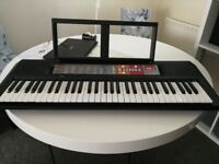 Electronic Yamaha keyboard + charger +stand + music sheet holder as new