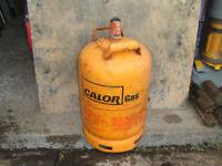 Empty yellow calor gas bottle