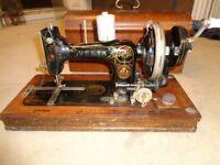 Antique vesta sewing machine with hand winder