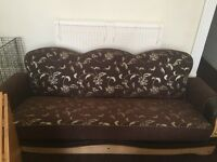 Brown and gold sofa bed