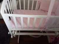 White v.i.b rocking or stable crib with bedding and drapes for boy or girl