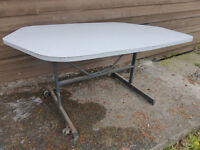 3 No. grey fold up plastic-topped trestle tables.