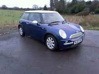 MINI COOPER 2003, ONE PREVIOUS OWNER , ONLY 75000 MILES. INDI BLUE, TWO TONE LEATHER INTERIOR.