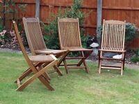 Four genuine teak folding garden chairs.