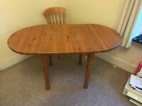 Solid pine dining table and 4 chairs , ex Drumoak Kitchens, table top needs TLC. Chairs VGC