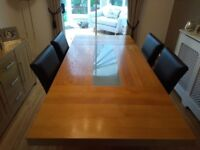 OAK VENEER DINING TABLE AND 4 FAUX LEATHER CHAIRS