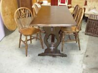 solid oak table and 4 wheel back chairs