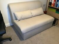 Modern double sofa bed in light beige fabric, hardly used and in excellent condition