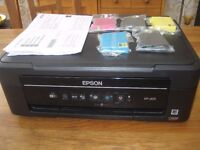 EPSON XP - 205 printer/scanner/copier (not working) with five NEW cartridges.