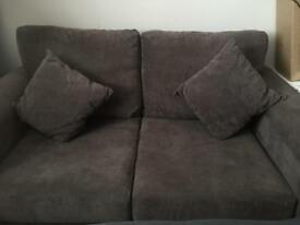 Two seater chocolate brown sofa