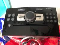 Corsa D stereo and badge
