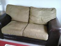 two seater sofa , brown leather with green fabric cushions. very good condition, smoke & pet free.