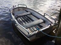 Boat, trolling motor, battery, charger, oars, anchor, plus more