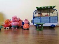 Large bundle of Peppa Pig toys.