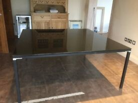 Large black gloss boardroom table