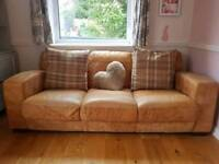 3 piece brown natural leather sofa. 3 seater, 2 seater and opening pouffe.