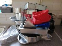 large selection of cake baking tins and accesories