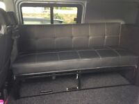 VW T5 or T4 or any van. Long seat and roll out bed