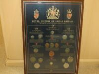 Framed coin collection.