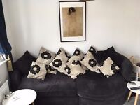BLACK FABRIC CORNER / LOVE SEAT SOFA IN VERY GOOD CONDITION WITH CUSHIONS ...FREE LOCAL DELIVERY