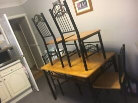 Wooden and metal dining table with 4/5 chairs