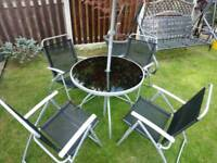 Garden table and chairs with umbrella
