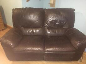 2 100% real leather recliner sofas.