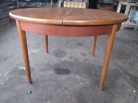 Round Extendable Dining table . plus four chairs .