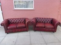 A Pair Of Oxblood Red Leather Chesterfield Sofas