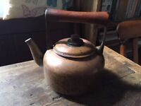 Traditional Copper kettle with wooden handle.