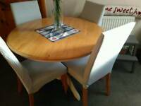 NEXT SET OF FOUR HIGH BACKED PADDED DINING CHAIRS, WITH LIGHT WOOD LEGS