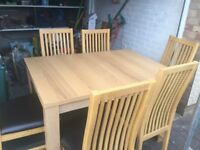 Oak veneer table and 6 faux brown leather chairs good condition